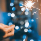 People Lighting Sparklers for the Holidays