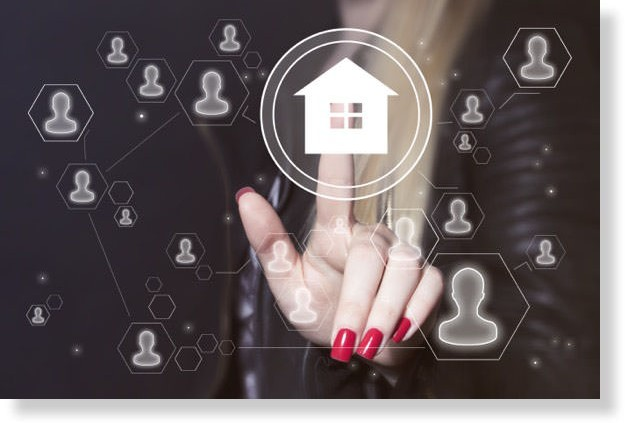 women touching a home on a screen